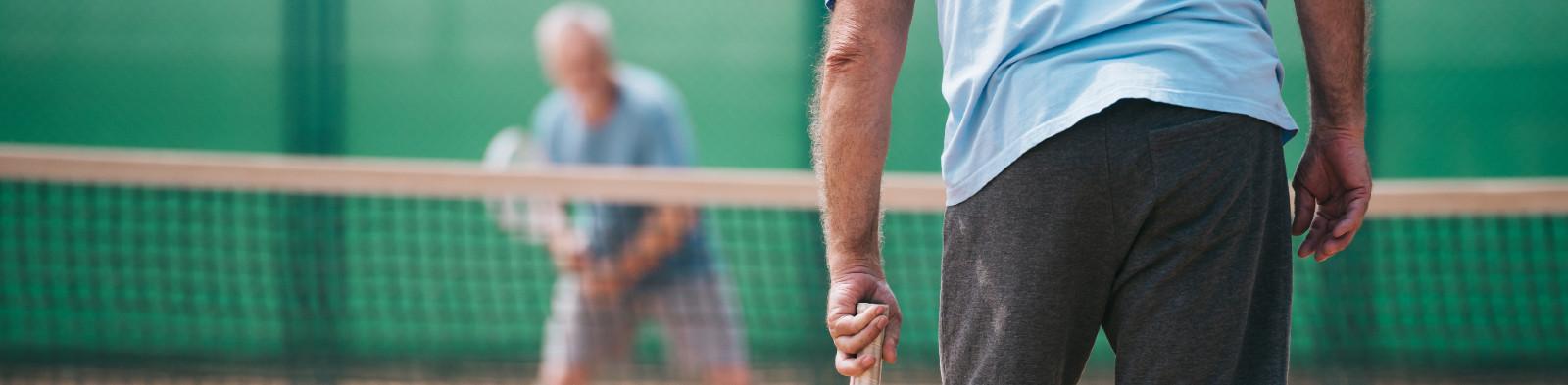 Elderly gentlemen playing tennis