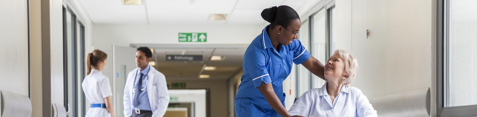 Nurse and patient in hospital corridor