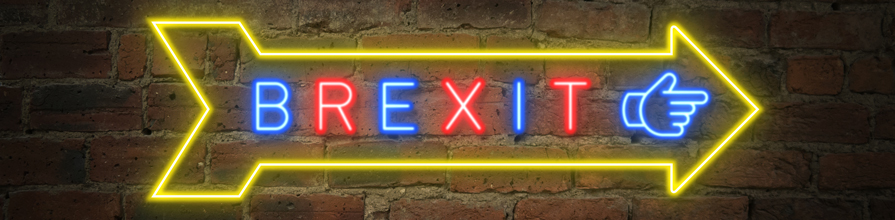 Brexit neon exit sign on brick wall