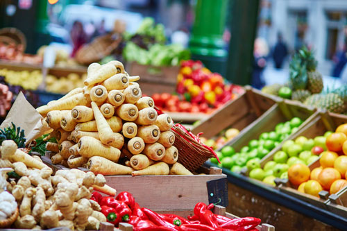 Parsnips and other fruit and veg at a market