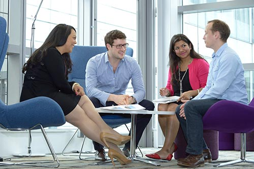 Image of 4 people sitting and discussing