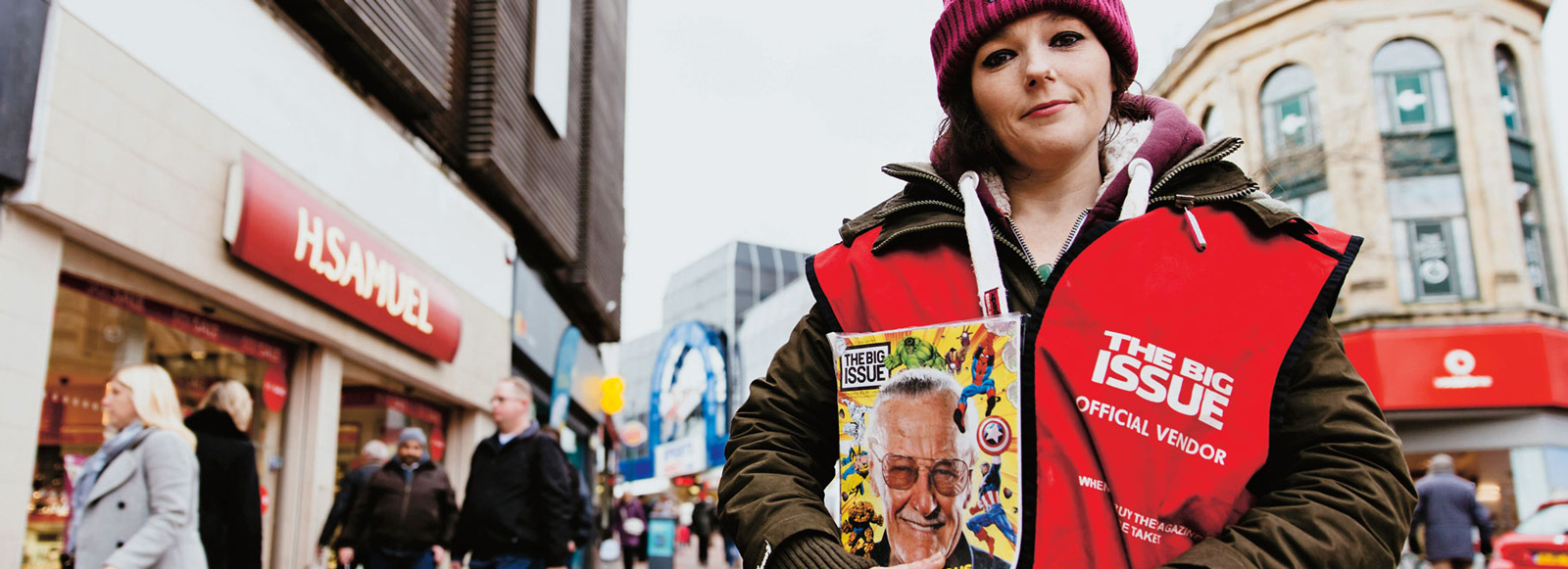 Josie Doyle holding a copy of the Big Issue