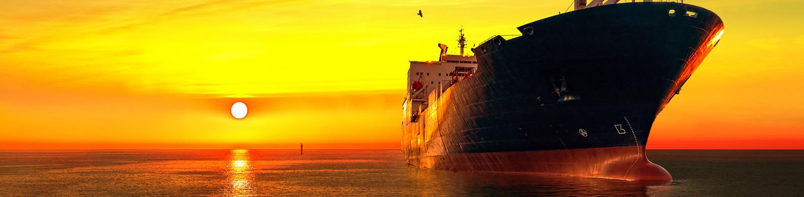 Oil tanker sailing at sunset